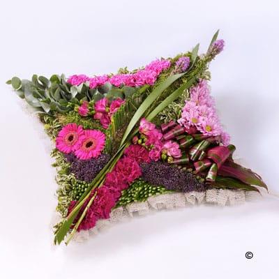 Flowers in a pin cushion arrangement