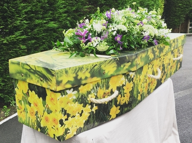 Custom coffin with flowers on