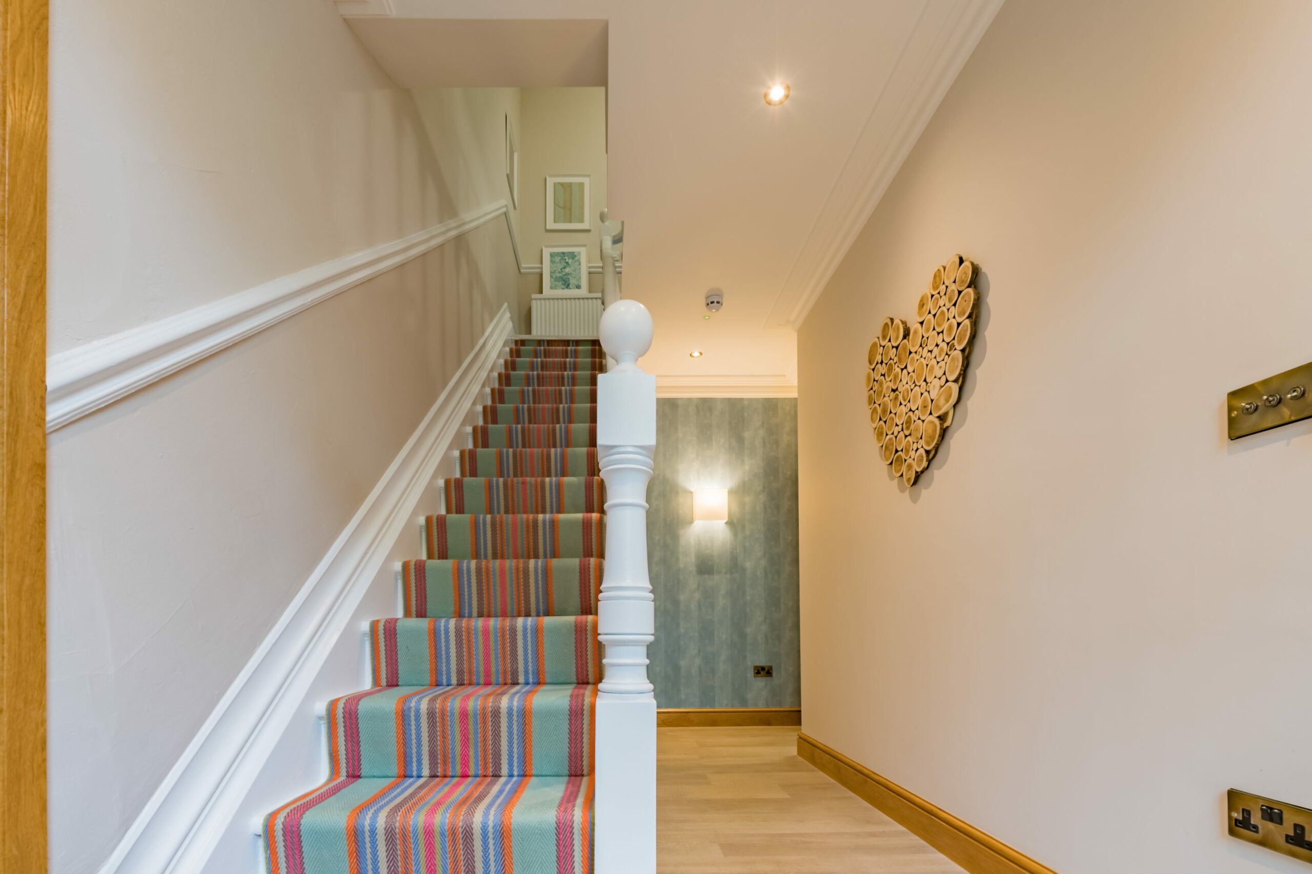 Hallway with stairs and heart shaped logs