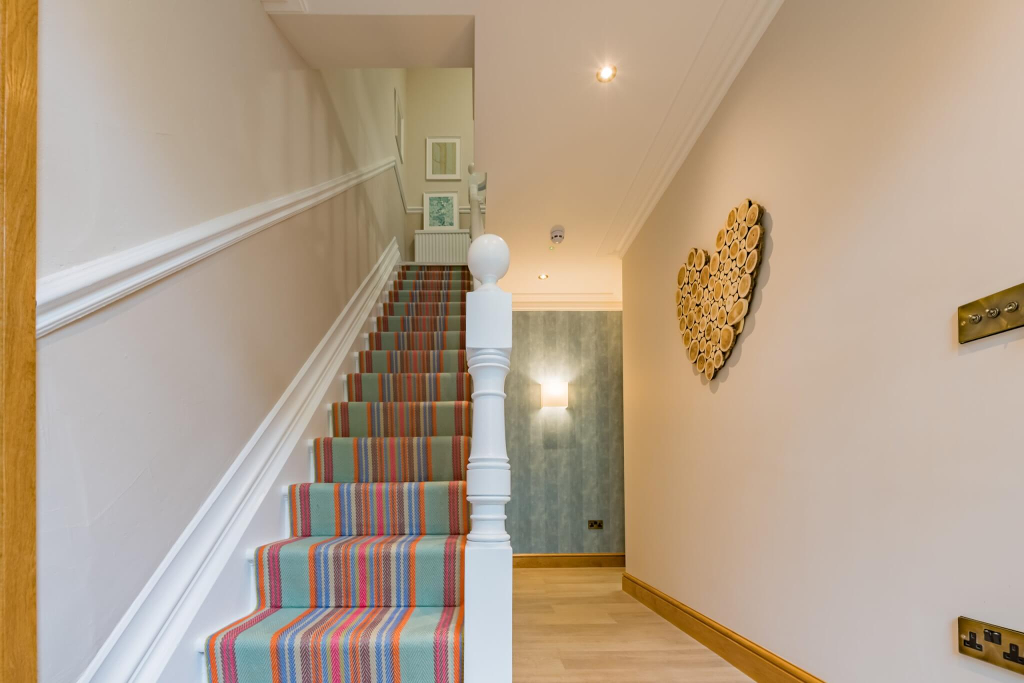 Hallway with stairs and log heart