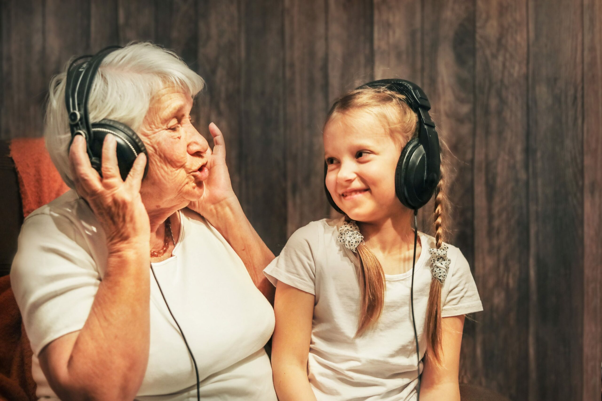 Old person and child listening to music