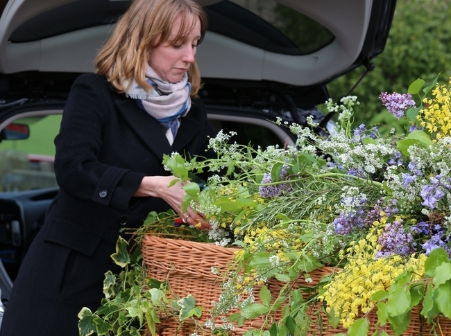 Woman adding flowers onto a coffin