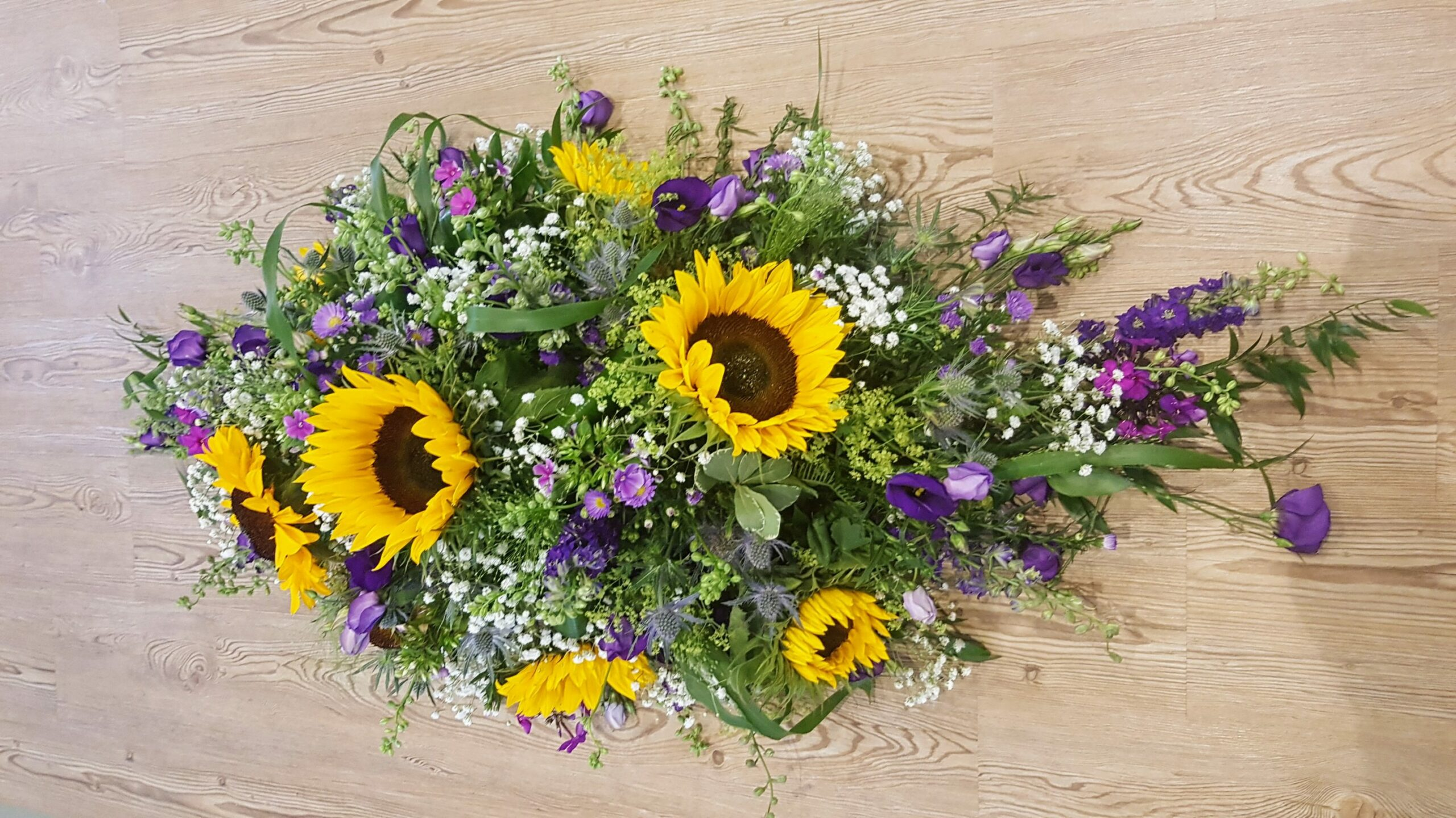 Sunflowers and other flowers in a bouquet