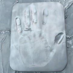 Hand print in clay